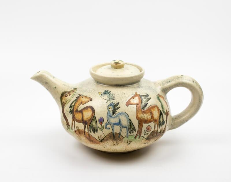 Runde Teekanne mit Märchen (Pferd) Muster